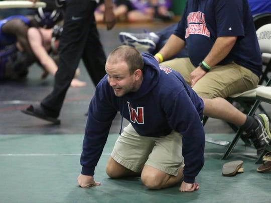 Wakulla wrestling coach Will Pafford watches a match intensely.