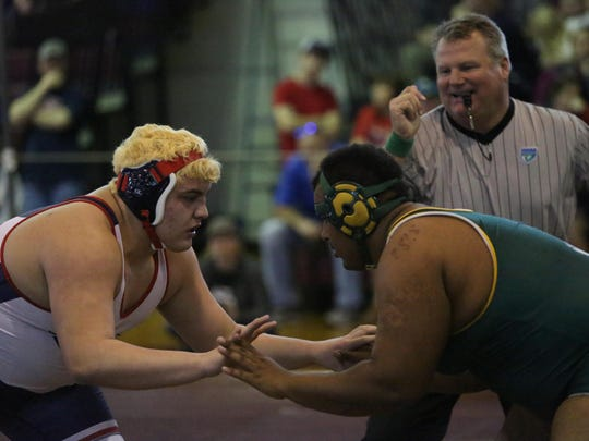 Wakulla's Jacob Marin wrestles a Suwannee wrestler during last year's district tournament.