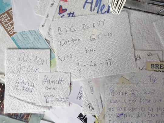Notes left by patrons are part of the table decor at the Ozark Cafe in Jasper, Arkansas.