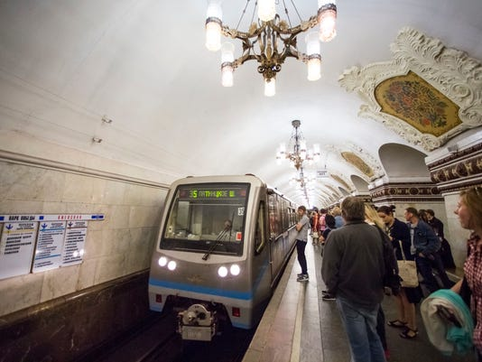 People stand at Kievskaya subway (Metro) station in Moscow, Russia, Tuesday, June 20, 2017. The Moscow subway hopes to provide an easy, safe and cheap way to travel around Moscow during the Confederations Cup or next year's World Cup. (AP Photo/Alexander Zemlianichenko)