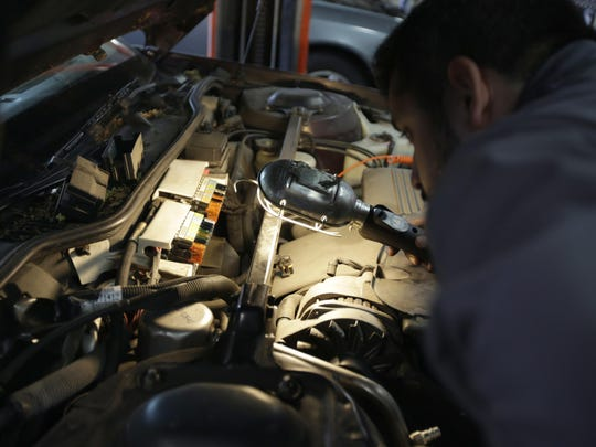 Mechanic Chris Geropoulos works on car at Ted's Auto Clinic in Chicago. In looking for a mechanic, experts say it's a good idea to establish a relationship and find a repair shop you can trust, or you may risk big problems.