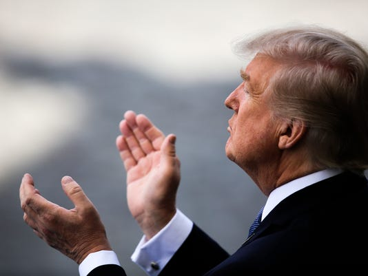 U.S President Donald Trump applauds as he attends the Bastille Day parade in Paris, Friday, July 14, 2017. Paris has tightened security before its annual Bastille Day parade, which this year is being opened by American troops with President Donald Trump as the guest of honor to commemorate the 100th anniversary of the United States' entry into World War I. (AP Photo/Markus Schreiber)
