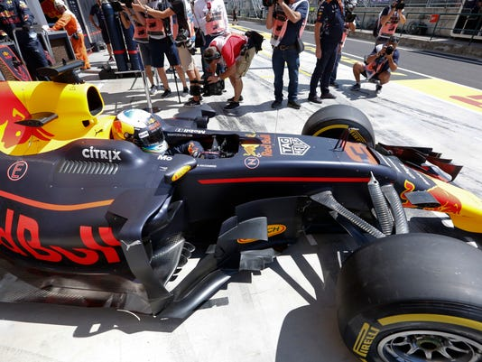 Red Bull driver Daniel Ricciardo of Australia leaves the pit during the second free practice session at the Hungaroring racetrack in Mogyorod, northeast of Budapest, Hungary, Friday July 28, 2017. The Hungarian Formula One Grand Prix will be held on Sunday July, 30. (AP Photo/Darko Bandic)