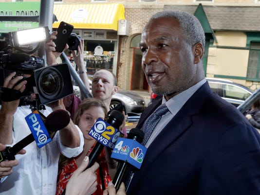FILE - In this April 11, 2017, file photo, former New York Knicks star Charles Oakley talks to the press after an appearance in Manhattan Criminal Court, in New York. Oakley has sued the team's owners, saying he was defamed when they claimed he committed assault and was an alcoholic. The lawsuit details how Oakley was treated before and after he was forcefully removed from Madison Square Garden during a Feb. 8 game. The lawsuit filed Tuesday, Sept. 12, 2017, seeks unspecified damages. (AP Photo/Richard Drew, File)