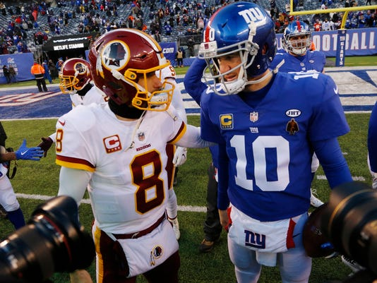 Washington Redskins quarterback Kirk Cousins (8) greets New York Giants quarterback Eli Manning (10) after an NFL football game Sunday, Dec. 31, 2017, in East Rutherford, N.J. (AP Photo/Mark Lennihan)