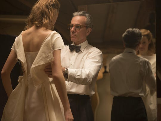 Vicky Krieps, left, and Daniel Day-Lewis appear in