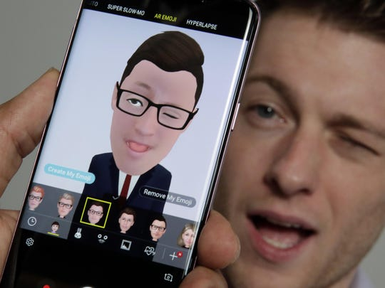 Samsung's Aaron Baker demonstrates the AR Emoji feature on a Samsung Galaxy S9 Plus mobile phone.