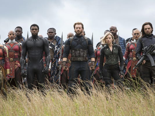 """This image released by Marvel Studios shows, front row from left, Danai Gurira, Chadwick Boseman, Chris Evans, Scarlet Johansson and Sebastian Stan in a scene from """"Avengers: Infinity War."""" The Walt Disney Co. said Saturday that the Marvel superhero saga had earned just under $975 million in global box office through Friday. Since the film earned nearly $70 million on Friday alone, the studio is confident it will pass the billion-dollar mark on Saturday, in 11 days."""