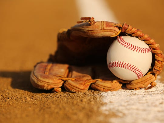 Baseball in a Glove on the Infield