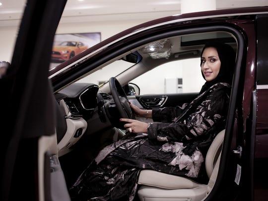 In this June 21, 2018 photo, car saleswoman Maram Al-Hazer