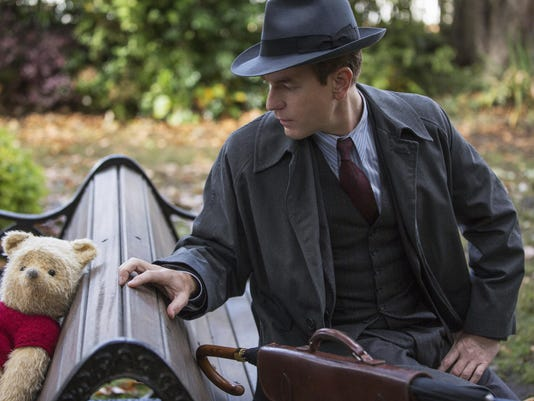 """This image released by Disney shows Ewan McGregor in a scene from """"Christopher Robin."""" (Laurie Sparham/Disney via AP)"""
