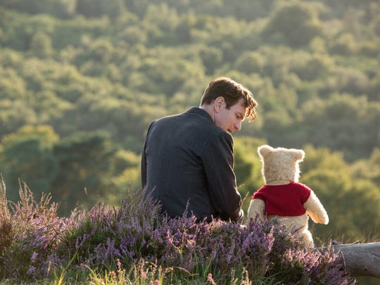 "Christopher Robin (Ewan McGregor) with his longtime friend Winnie the Pooh in Disney's live-action adventure ""Christopher Robin."""