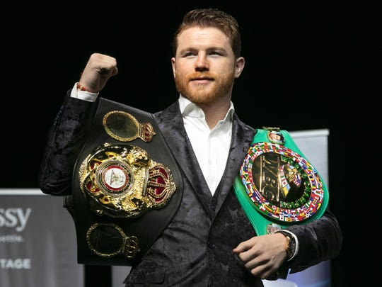 Boxer Canelo Alvarez poses for photos at Madison Square Garden in New York, Wednesday, Oct. 17, 2018. He will meet Rocky Fielding in a 12-round, super middleweight bout Dec. 15, 2018. (AP Photo/Richard Drew)