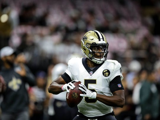 Oct 8, 2018; New Orleans, LA, USA; New Orleans Saints quarterback Teddy Bridgewater (5) against the Washington Redskins before a game at the Mercedes-Benz Superdome. Mandatory Credit: Derick E. Hingle-USA TODAY Sports