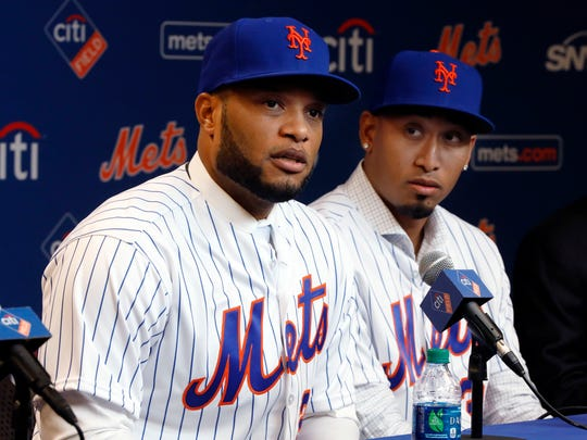 Robinson Cano, left, and Edwin Diaz participate in a news conference at CitiField, in New York, Tuesday, Dec. 4, 2018. The Mets acquired eight-time All-Star second baseman Robinson Cano and major league saves leader Edwin Diaz from the Seattle Mariners in a seven-player trade Monday. (AP Photo/Richard Drew)