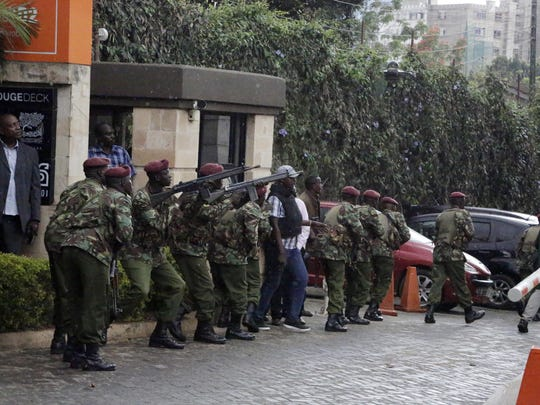 Security forces are seen at the scene of a blast in Nairobi, Tuesday, Jan. 15, 2019.Terrorists attacked an upscale hotel complex in Kenya's capital Tuesday, sending people fleeing in panic as explosions and heavy gunfire reverberated through the neighborhood. (AP Photo/Khalil Senosi)