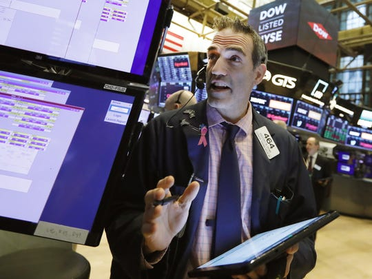 Trader Gregory Rowe works on the floor of the New York Stock Exchange, Tuesday, April 2, 2019. U.S. stocks moved broadly higher Thursday in morning trading, led by banks and internet companies.