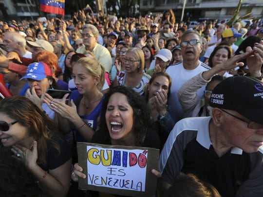 A supporter of opposition leader and self-proclaimed interim president Juan Guaido, cheers him on during a rally in a west side neighborhood in Caracas, Venezuela, Friday, April 5, 2019.