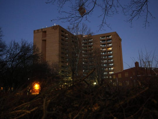 In this Feb. 25, 2019 photo, dusk settles over Rosemont Tower in Baltimore. Health and safety inspectors gave the 200-unit public housing high-rise a failing score of 25 out of a possible 100 in 2017. The score improved to 71 last year, according to housing authority officials.