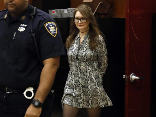 Anna Sorokin returns from a recess during her trial at New York State Supreme Court, in New York, Monday, April 22, 2019. Sorokin, who claimed to be a German heiress, is on trial on grand larceny and theft of services charges.