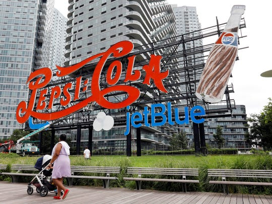 An LED-lighted JetBlue logo has been added to the landmarked, neon-lit Pepsi-Cola sign in the Long Island City neighborhood of New York's Queens borough. The promotion is slated to remain until Oct. 1.