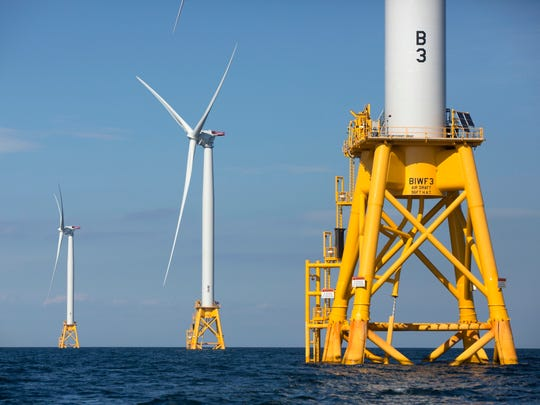 Three of Ørsted's turbines in the water off Block Island, Rhode Island.