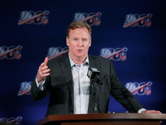 FILE - In this May 22, 2019, file photo, NFL Commissioner Roger Goodell speaks to the media during an NFL football owners meeting in Key Biscayne, Fla. NFL owners gather for their winter meeting amid talk of labor negotiations, the future of pass interference review and another episode of the New England Patriots being investigated over questions of inappropriate filming of a future opponent's sideline. (AP Photo/Brynn Anderson, File)