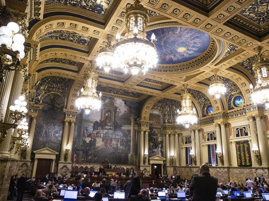 In this Nov. 19, 2019, photo is the Pennsylvania House of Representatives chamber at the Capitol in Harrisburg, Pa. It takes hundreds of millions of dollars a year for the Pennsylvania General Assembly to maintain what is one of the country's largest legislative staffs, a small army with a voracious appetite for food, shelter, transportation, office supplies and computer equipment. (AP Photo/Matt Rourke)