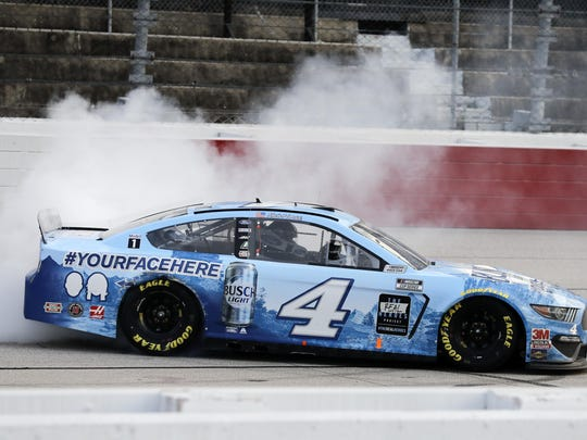 Kevin Harvick does a burnout after winning the NASCAR Cup Series auto race Sunday in Darlington, S.C.