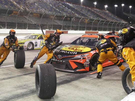 Martin Truex Jr. makes a pit stop during the NASCAR Cup Series auto race Wednesday in Darlington, S.C.