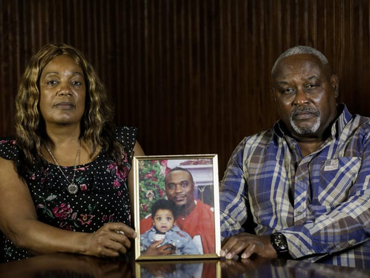 Maritza Ambler and husband, Javier, sit next to a photo of their son Javier Antonio Ambler II. He died in March 28, 2019, in the custody of Williamson County deputies.