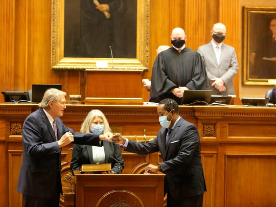 South Carolina Senate President Harvey Peeler, R-Gaffney, left, and Sen. Darrell Jackson, D-Hopkins, right, bump fists after Peeler was reelected president of the Senate and took his oath of office at the Statehouse in Columbia, S.C., on Tuesday.