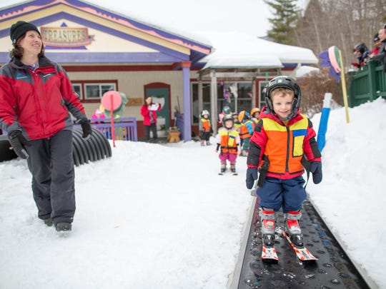 The 2 1/2 and 3 year olds in the nursery's introductory ski program show off their new ski skills in a weekly Cookie Race on the nursery's dedicated slope with glider lift at Smugglers' Notch Resort.