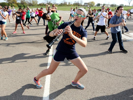 Darby Nabb, and other members of the Mason High Marching Band practice movements for an upccoming performance. The 320 member band practices daily after school.