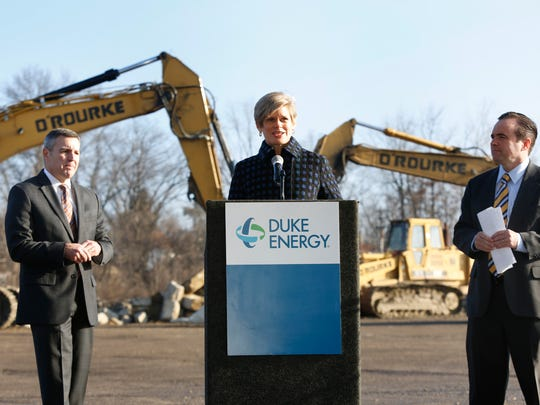 James P. Henning, Duke Energy, Port of Greater Cincinnati Development Authority President Laura Brunner, and Cincinnati Mayor John Cranley are at a press conference in 2010, in which Duke Energy presented a $400,000 check to the Port Authority for a development project in Bond Hill.