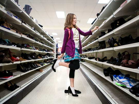 Zay tries on high heels at TJ Maxx in Beavercreek. She walked up and down the aisles with confidence and shaky ankles. The Enquirer/Meg Vogel