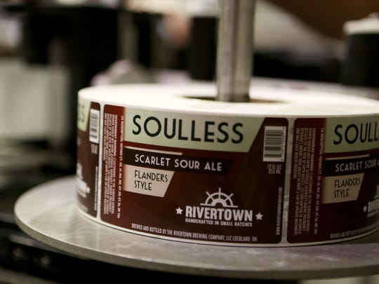 Labels for Soulless, a sour ale by Rivertown Brewing Company in Lockland. Photo shot Thursday February 5, 2015. The Enquirer/ Cara Owsley.