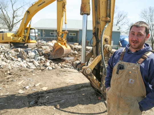"""Property owner and construction contractor Tim Thompson says that with the fertilizer plant's construction, """"from 4 to 6 (p.m.), it's just one car after another"""" in the Wever area. He has lived there for 28 years."""