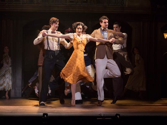 "Caroline Bowman (Eva); Josh Young (Che) and Sean MacLaughlin (Perón) perform in the National Tour of ""Evita,"" the Tony Award-winning musical by Tim Rice and Andrew Lloyd Webber."