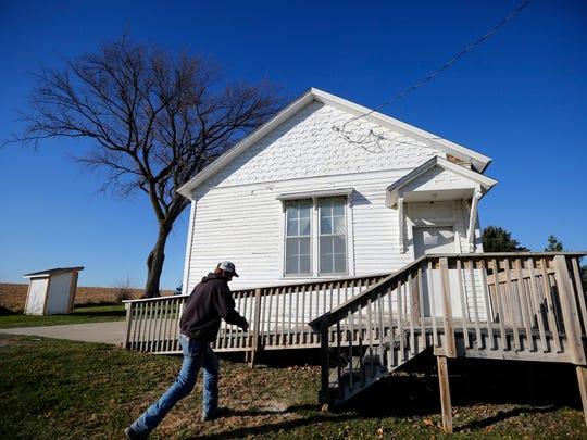 John Adams votes in a former one-room schoolhouse in rural Madison County on Tuesday.