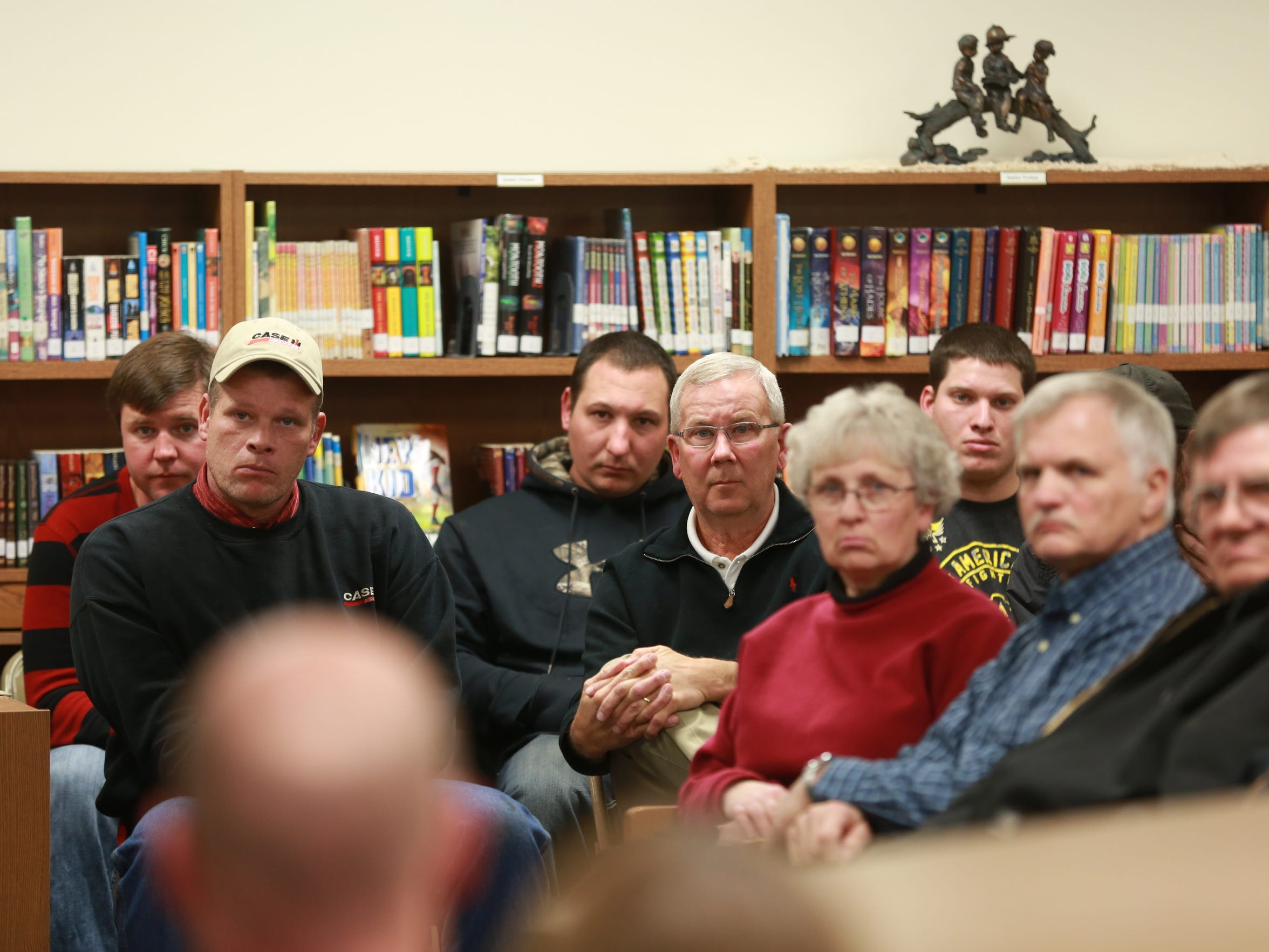 School board members and civic leaders gather to discuss the future of the Corwith-Wesley-Lu Verne high school building at a special meeting Tuesday of the Corwith City Council following the dissolution of the district at the conclusion of the 2014-2015 school year.