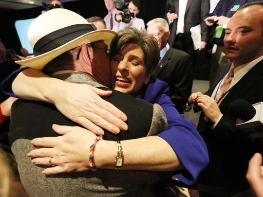 Republican Sen.-elect Joni Ernst hugs a supporter at her election night celebration party in West Des Moines.