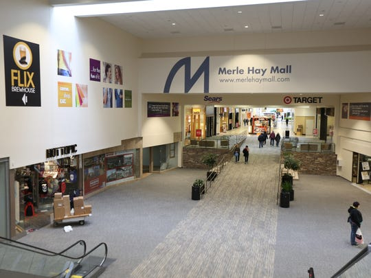 Shoppers walk through the newly renovated portion of Merle Hay Mall on Thursday. The bridge court was under construction for 18 months to make way for Flix Brewhouse, a eight-screen movie house, restaurant and microbrewery.