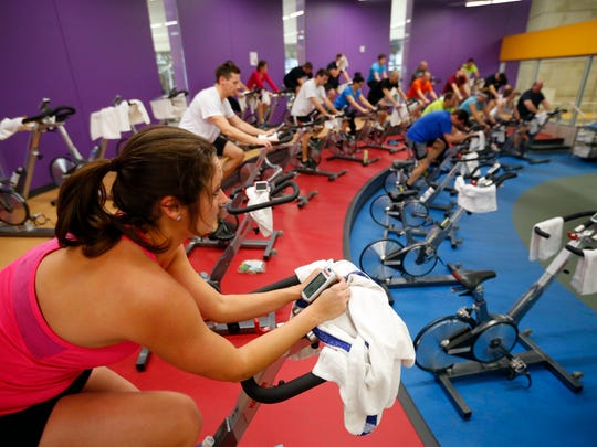 Emily Zach rides a spinning bike during a class Feb. 17 at the Wellmark YMCA in downtown Des Moines.