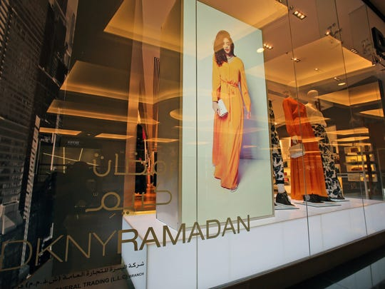 In this July 2014 photo, part of the DKNY Ramadan collection is seen on display at a shopping mall in Dubai, United Arab Emirates. Some mainstream fashion houses have started to cater to the growing demand for stylish modest wear. This summer, DKNY released a collection during Ramadan that sold exclusively in the Arabian Gulf.