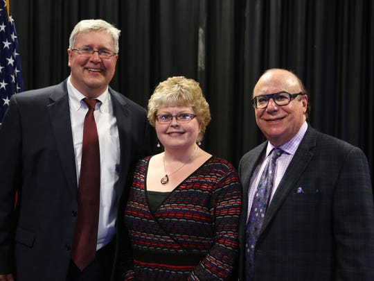 Mary Kay Gee, center, who works at the Carleton Senior Care and Rehab Center in Wellsboro was chosen as one of seven caregivers from across the state recognized recently for her extraordinary contributions toward the care of Pennsylvania's seniors. At left is David Leader and at right is Stuart H. Shapiro of the Pennsylvania Health Care Association/Center for Assisted Living Management.