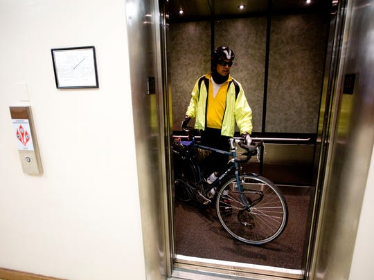 Bicycle commuter, Guy Hackett heads into his office at the Lee County Clerk of Courts in Fort Myers on Wednesday 1/28/2015. The Lee County Sheriff's Office issued him the ticket for slow bike, fail to ride to right curb. He was found not guilty. He has a pair of accreditations for safe cycling from national groups for which he's an instructor and has been commuting by bike for a decade.