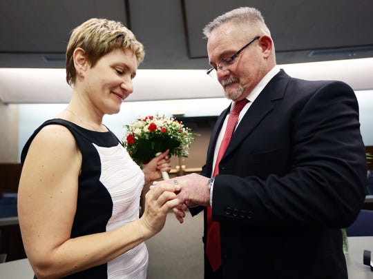 Alla Ruchkina put a ring on David Lee Brown during their wedding in Judge Ardis' courtroom Thursday afternoon.