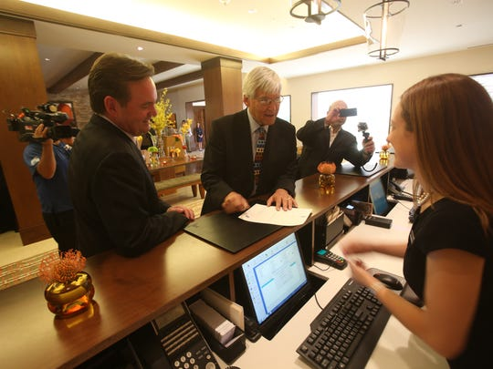 GM Doug Watson helps Geoffrey Cowan, Annenberg Foundation and Trust at Sunnylands president, as the Ritz-Carlton's first honorary check-in.