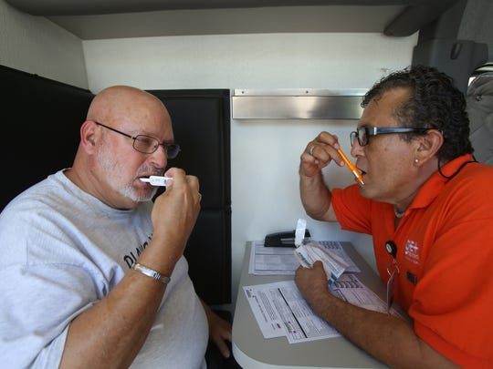 Kurt L. Jacobowitz-Cain, left, gets tested with the